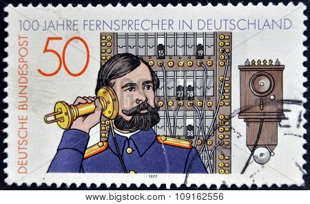 GERMANY - CIRCA 1977: stamp printed in Germany shows telephone operator circa 1977.