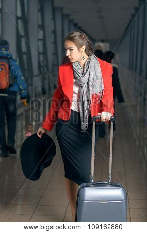 Woman Is On The Move With A Suitcase