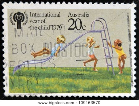 stamp printed in Australia dedicated to the International Year of the Child shows Children playing