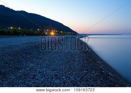 Coast of sea with mountains in night