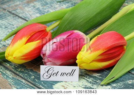 Get well card with colorful tulips on rustic wooden surface