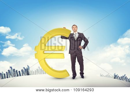 Businessman leaning on euro sign