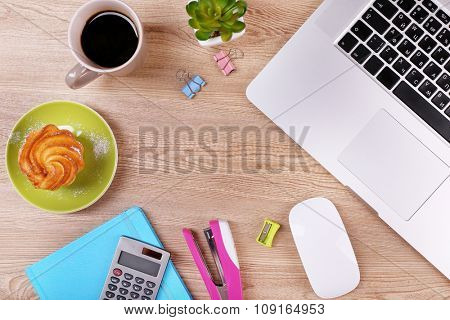 Top view of comfortable working place on wooden background
