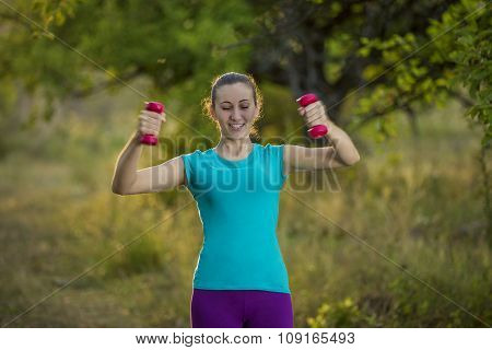 Girl with red dumbbells