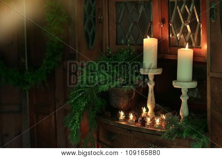 Christmas candles in needles