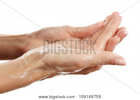 Woman's hands using scrub isolated on white