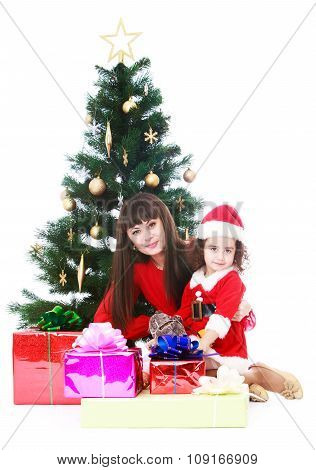 Mom and daughter at Christmas tree