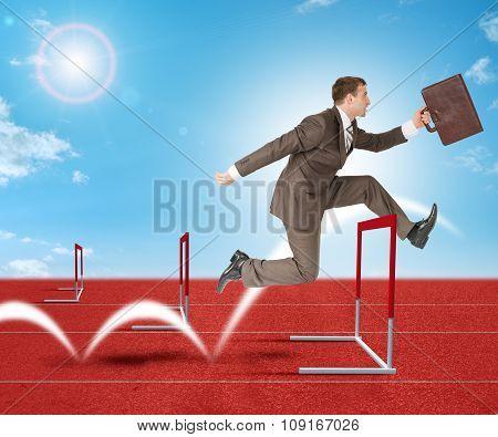Man hopping over treadmill barrier