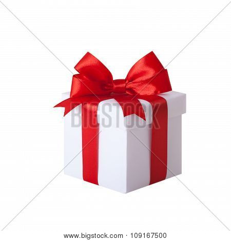 Gift box with red ribbon and bow. Present.