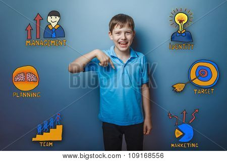 Teen boy points his finger down and laughing joy collection of b