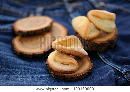 Homemade Puff Cookies On Wooden Stands On Old Jeans Selective Focus