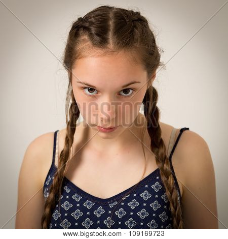 Beautiful Teenage Girl With Plaits And Onesie