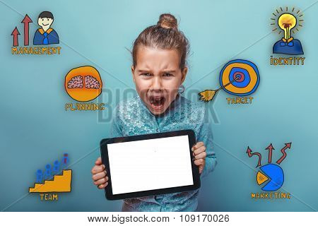 teen girl holding a tablet in his hands opened her mouth and sho