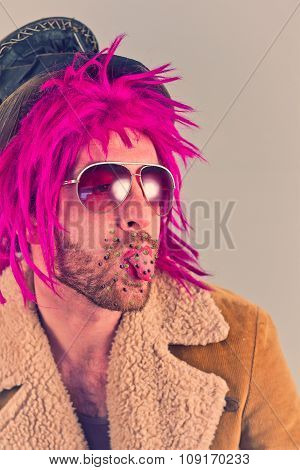 Bacteria virus sickness on tongue of hip bearded pink haired man