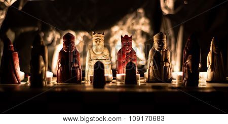 Lewis chess set replica lit by candlelight