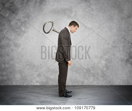 Businessman with key in back