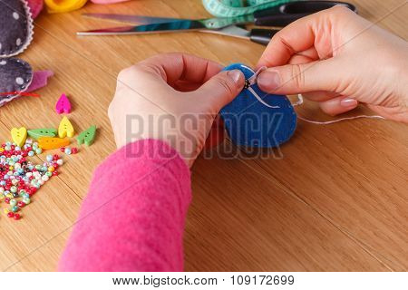 Female Hands Doing Crafts From Felt