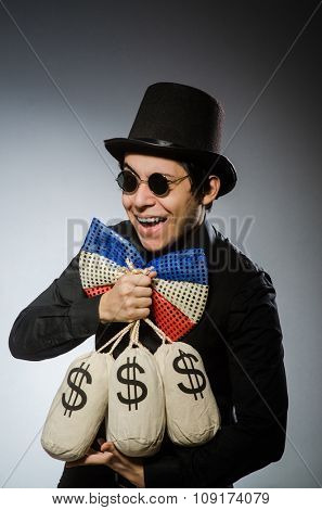 Funny man with money dollar sacks