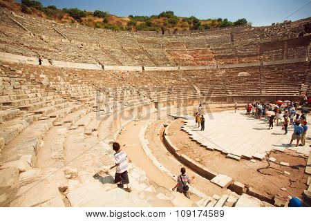 Historical Theater And Tourists Climbing On The Ancient Stone Steps