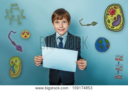 Teenage boy smiling businessman holding a piece of paper and a s