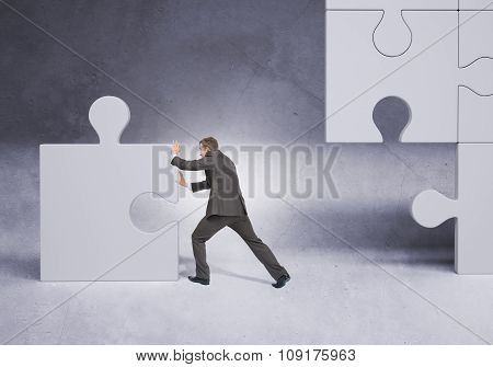 Man pushing puzzle piece