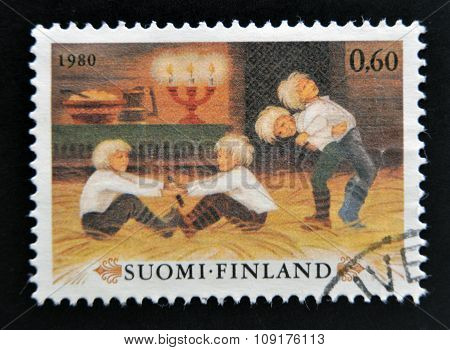FINLAND - CIRCA 1980: stamp printed in Finland shows Boys playing Christmas Games circa 1980