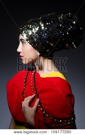 Woman in fashion concept in dark studio