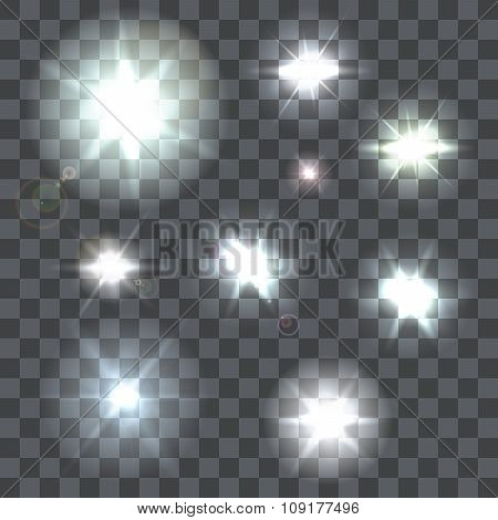 Set of vector lens flares beams and flashes on transparent background