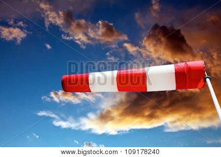 Windsock And Stormy Clouds
