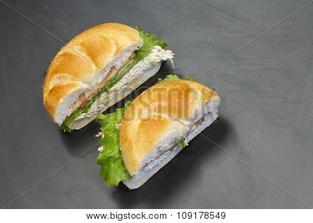 Bound seafood salad sandwich with mayo on a kaiser roll
