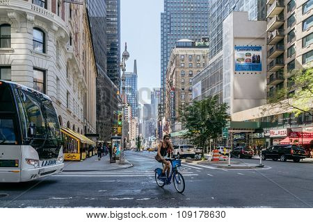 Girl Rides A Bike On The Street In New York