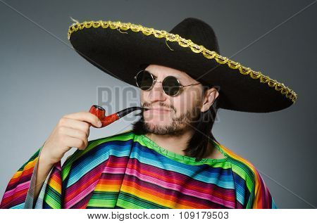 Mexican smoking pipe wearing sombrero