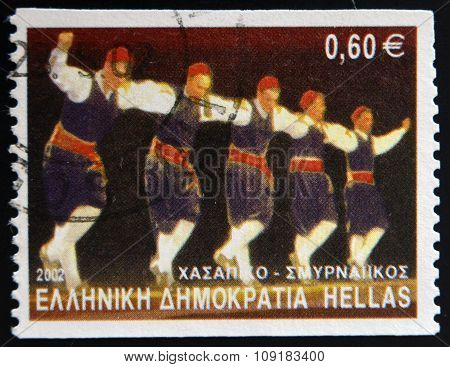 A stamp printed in Greece dedicated to Greek Dances shows Hassapiko dance Smyrna