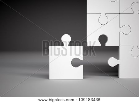 Puzzle pieces on grey background