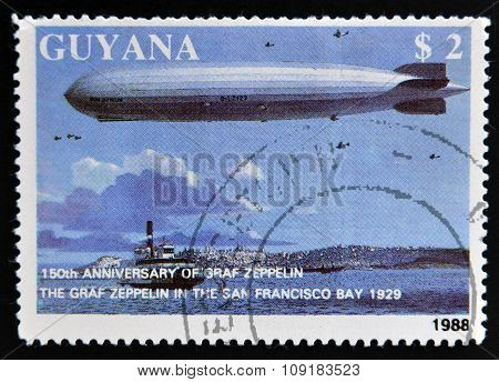 A stamp printed in Guyana shows 150th anniversary of Graf Zeppelin The Graf Zeppelin