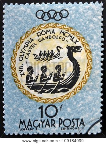 A stamp printed in Hungary shows Rowers devoted to the Olympic games in Rome