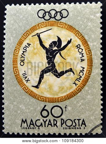 A stamp printed in Hungary shows Javelin devoted to the Olympic games in Rome