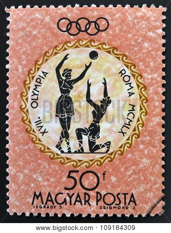 A stamp printed in Hungary shows women's volleyball devoted to the Olympic games in Rome
