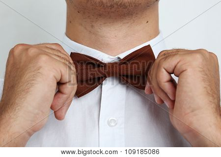 Man's Hands Touching Bow-tie