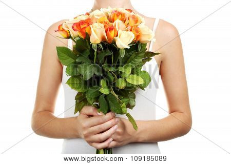 Female Hands Holding Bouquet Of Orange Roses