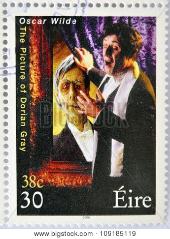 a stamp printed in Ireland shows an image commemorative of The picture of Dorian Gray