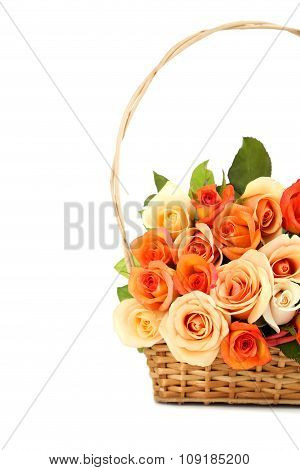 Bouquet Of Orange Roses In Basket On White Background