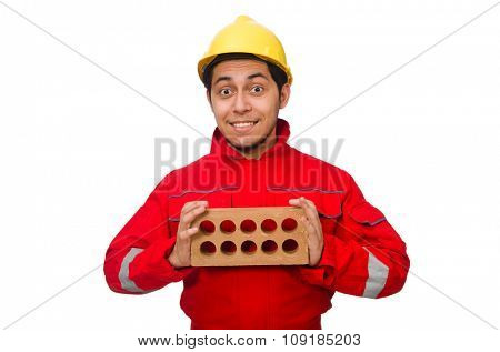 Construction worker with clay bricks on white