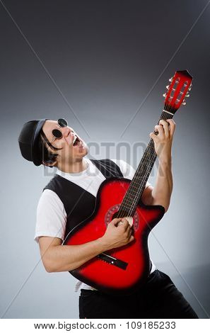 Funny guitar player in musical concept