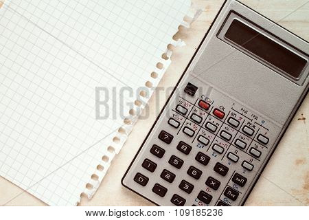 Old Calculator And Blank Square Paper