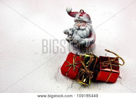 Christmas Decoration,snowy Figure Of Santa Claus And Three Gift Packets.horizontal.