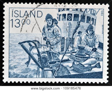 ICELAND - CIRCA 1983: A stamp printed in Iceland shows fishermen circa 1983