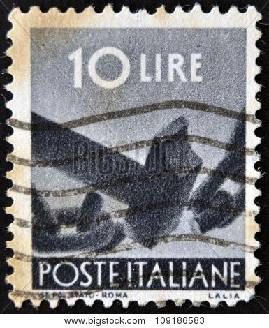 ITALY- CIRCA 1961: A stamp printed in Italy shows hammer breaking chain circa 1961