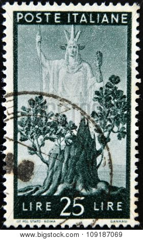 ITALY - CIRCA 1945: stamp printed in Italy shows Italia and Sprouting Oak Stump circa 1945