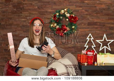 Pretty Hipster Woman Opening Christmas Presents